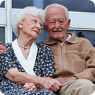 An elderly couple sitting together